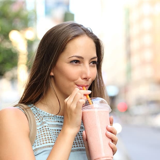 Image: Woman drinking a smoothie