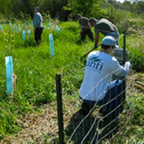 Image: UNFI associate working on fence.